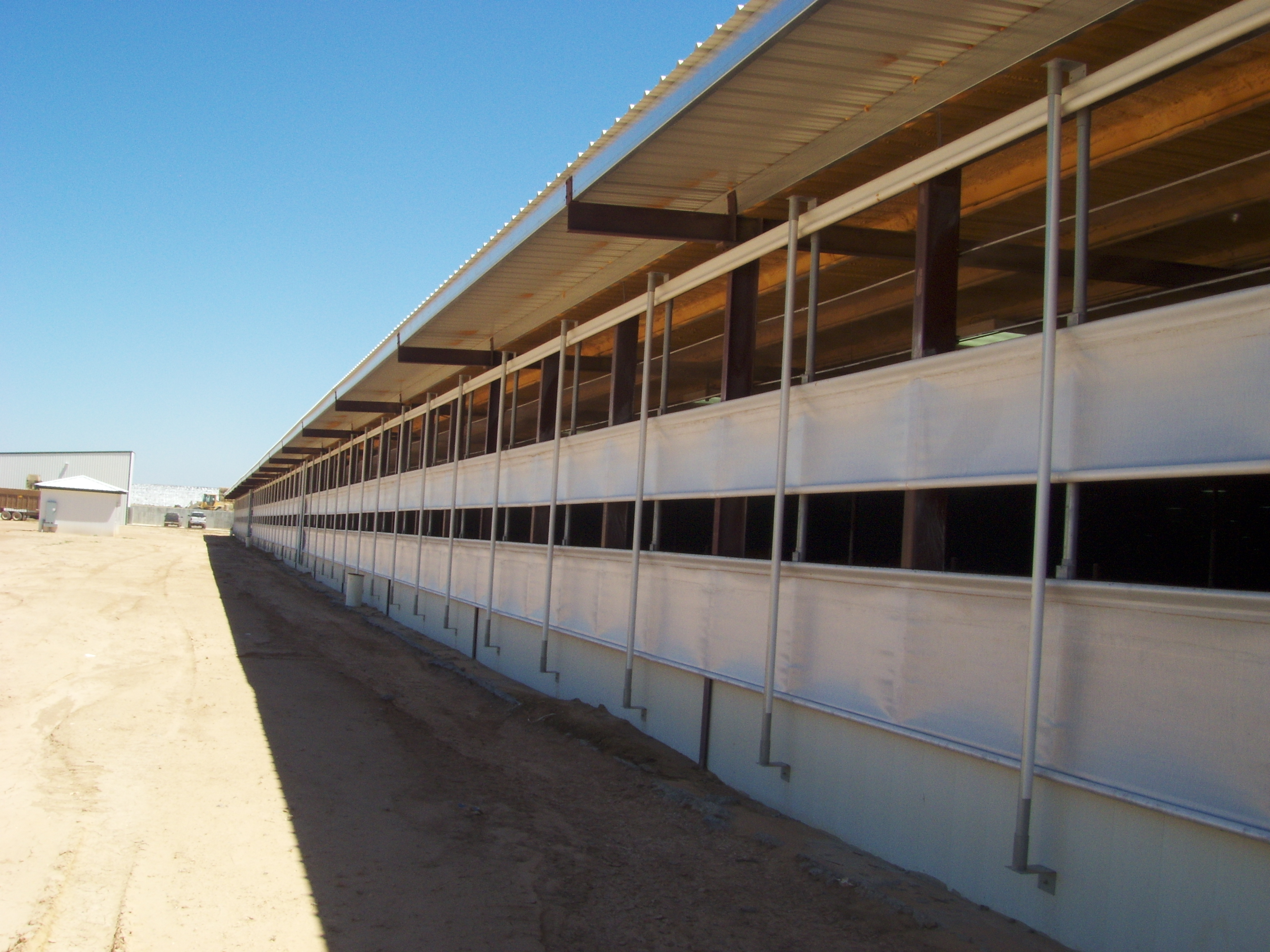 Roll-O-Matic: Agricultural & Livestock Barn Curtain System